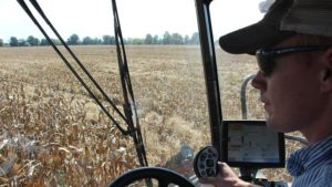 Farm manager Nate Long in the cab as he traverses the field during fall harvest 2016.