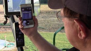 AgriSync farmer with iPhone