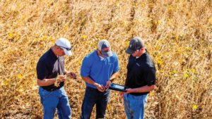 Ag Retailer and Growers with tablet WinField United